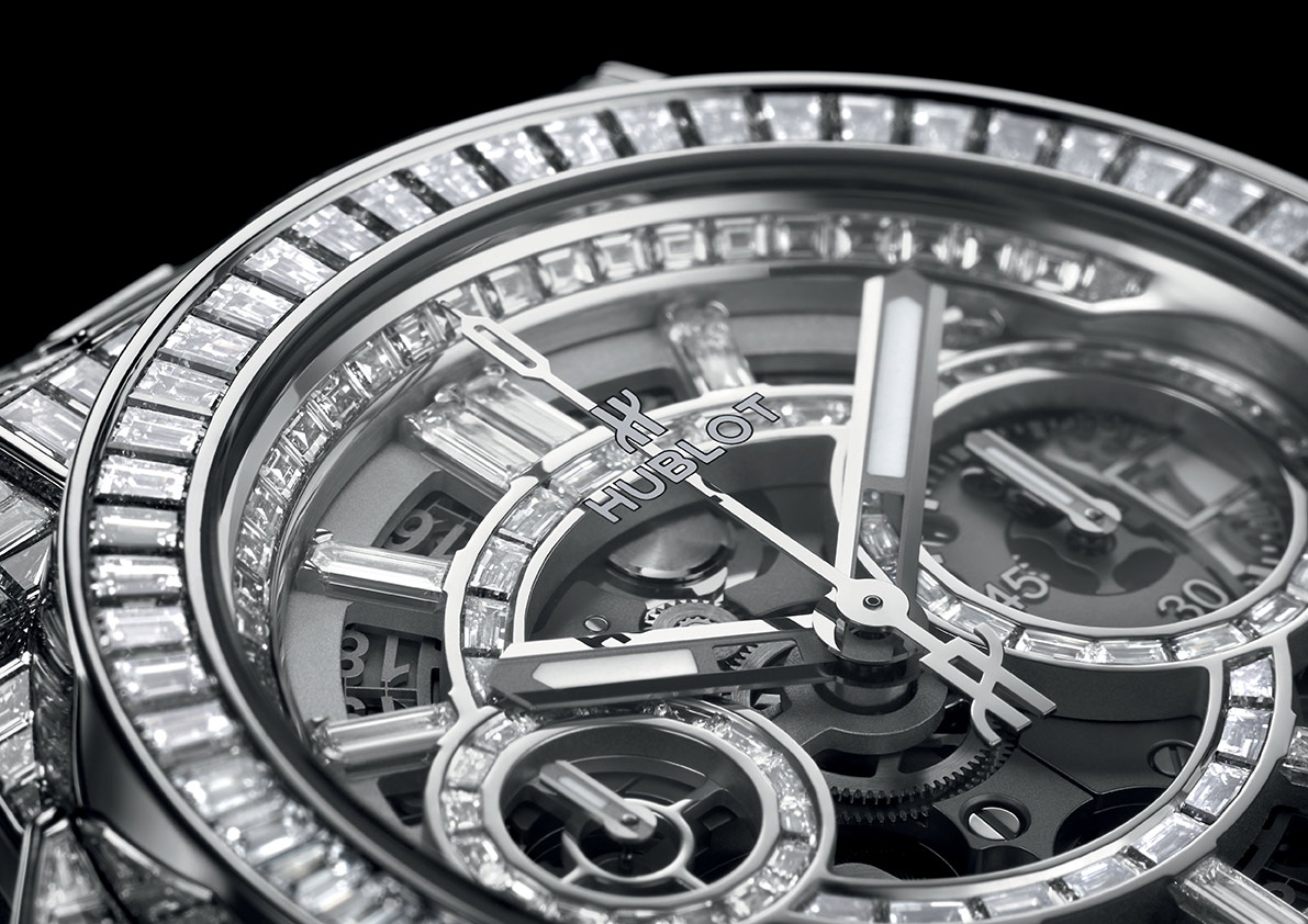 """STUNNING DEPTH HAUTE JOAILLERIE COLLECTION 2020  Hublot develops its precious movements From Haute Horlogerie to Haute Joaillerie (fine jewellery), the quality of the setting work is crucial in showcasing the splendour of precious stones. This highly specialised craft, performed within the bounds of strict predefined constraints, must be subtly executed to allow the brilliance of the stones to take centre stage. The radiance of precious stones is the result of the stone-setter's painstaking craftsmanship. Three new Hublot models marry the technical performance of the manufacture movements, the sophisticated beauty of diamonds and the expertise of master watchmakers.  <div  class='avia-video avia-video-16-9  '  itemprop=""""video"""" itemtype=""""https://schema.org/VideoObject"""" ><div class='avia-iframe-wrap'><iframe title=""""Hublot new Big Bang Unico High Jewellery 2020"""" width=""""1500"""" height=""""844"""" src=""""https://www.youtube.com/embed/7Q13_L7lrVY?feature=oembed"""" frameborder=""""0"""" allow=""""accelerometer; autoplay; clipboard-write; encrypted-media; gyroscope; picture-in-picture"""" allowfullscreen></iframe></div></div>  To stay up-to-date, follow: @Hublot #HublotHighJewellery Setting the stones on a watch is a feat of technical and aesthetic excellence, carefully conceived and determined in advance. The discipline is both a science of absolute precision and an art form, the aim of which is to maximise the brilliance of the stones within the limits of an extremely confined space. Overcoming such tough challenges and coupling tradition with innovation are the driving forces of our ambition.  Mechanical brilliance  Big Bang Unico High Jewellery – 334 baguette-cut diamonds – 12.5 carats Arranged in close rows in invisible closed settings on an 18-karat white gold background, 243 diamonds (8.6 carats) adorn the 42 mm case and the bezel, while 61 stones (1.3 carats) impart a contemporary opulence to the dial of the latest flyback chronograph movement. Its beating heart is the HUB1280 calibre, the"""